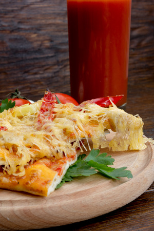 pizza with pineapple and chicken, hot pepper on a wooden background Stock Photo