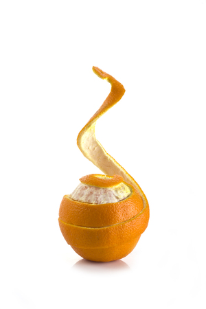 an orange on a white background with curly peel Stock Photo