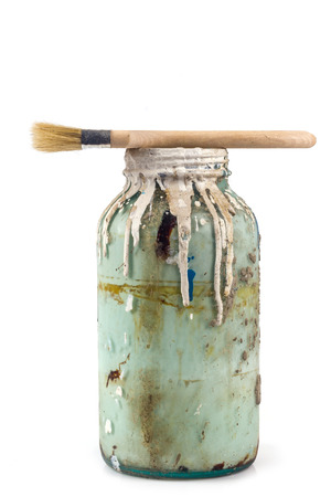 old container: Old container with paint and brush on white background