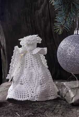 Christmas angel with a ball on the Christmas tree Stock Photo