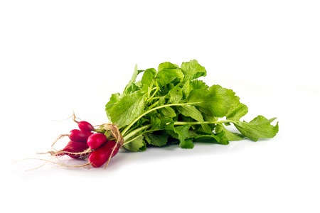 Bunch of a long radish with green leaves on a white background Stock Photo