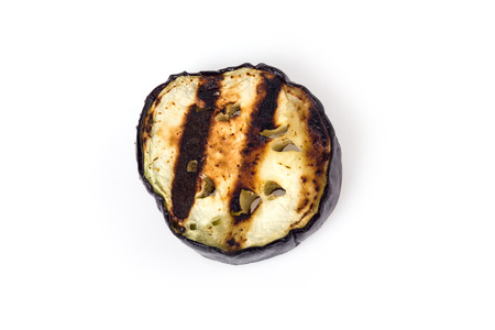 Slice of eggplant roasted on a grill with stripes from a grill on a white background Stock Photo