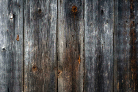 wood paneling: The old wood paneling. Location vertical. The background. Darkened by the time the tree. Rustic. Close-up. Stock Photo