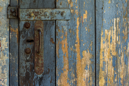 exit door: An Old Wooden Door With Cracked Paint. Background. Handle With Keyhole. The Old Iron. Stock Photo