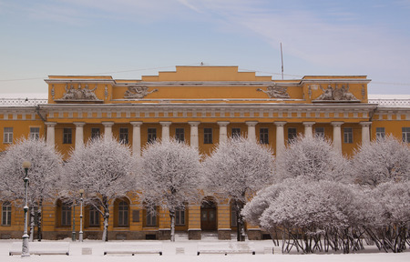 Winter view of Barracks of Pavlovsky life guard regiment (also known as Lenenergo building) through the trees covered with snow. The field of Mars architectural ensemble in St.Petersburg, Russia.