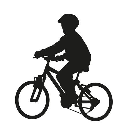 Youn boy on bike. Vector silhouette Vectores