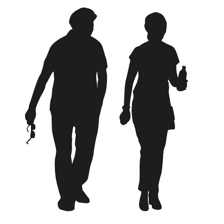 happy mature couple: Silhouette of an elderly couple on a walk
