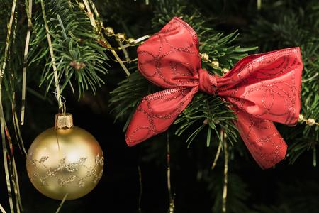 gold  ball: Christmas background with gold ball and red bow