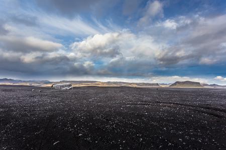 wreckage: Airplane wreckage on black sand beach. Douglas Dakota DC3, US navy, South Iceland