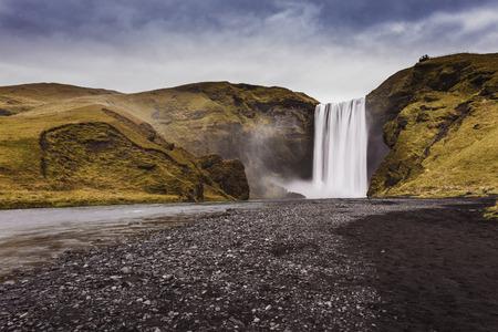 skogafoss waterfall: Skogafoss waterfall. Iceland. Long exposure, mysterious atmosphere