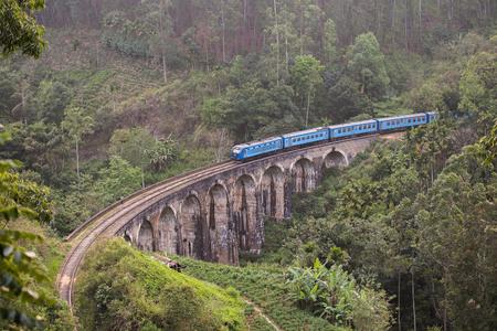 Blue train goes over the bridge, Sri Lanka Stock Photo