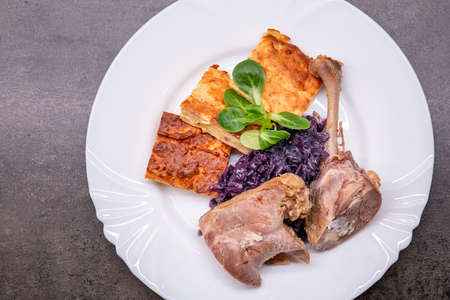 Roasted duck leg with red cabbage and potato pancake, light version. Healthy eating 写真素材
