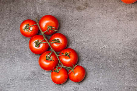 Fresh tomatoes on a dark background. Red cherry tomatoes. Top view