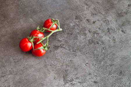 Cherry tomatoes on a dark background. Red cherry tomatoes, top view