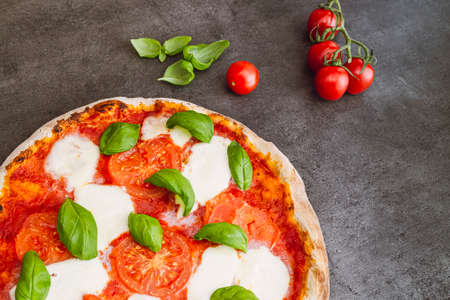 Pizza margherita on dark background. Traditional italian pizza, top view. Takeaway food 写真素材