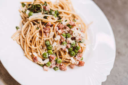 Spaghetti carbonara close-up detail, traditional main meal, healthy food on white plate 写真素材