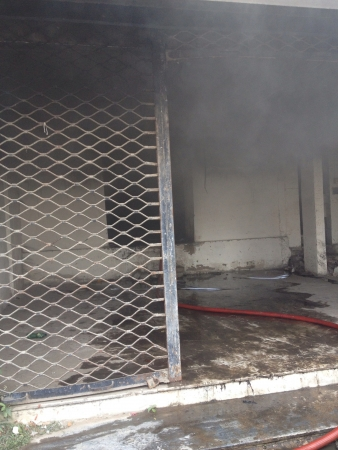 Fire smoke coming out from inside of an empty shop Stock Photo