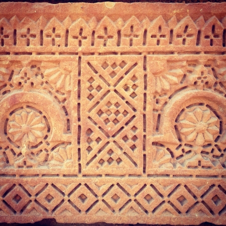 Ornamental design pattern on clay tomb