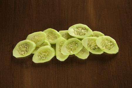 Sliced cucumber on wood