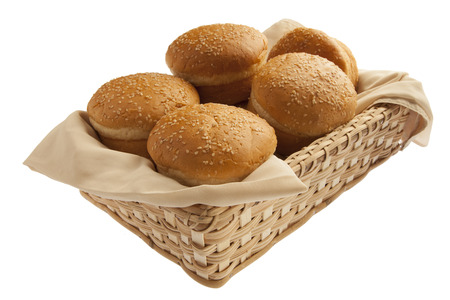 Scrumptious baked buns in basket isolated on white background
