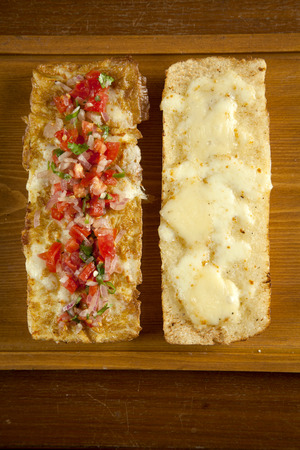 Toasted open faced salsa and egg sandwich with melted mozzarella cheese