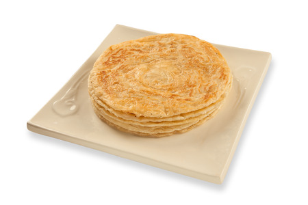 puri: Puri paratha stack on plate isolated on a white background Stock Photo