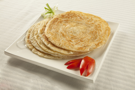 ramzan: Plain paratha puri served with freshly sliced tomato and cucumber