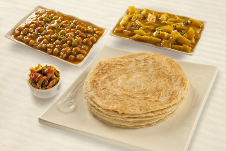 Puri paratha with chickpeas potato curry and pickels