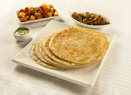 Indian pakistani desi cuisine paratha with mixed vegetables and pickles