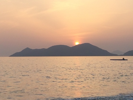 Sun set mountain beach Stock Photo