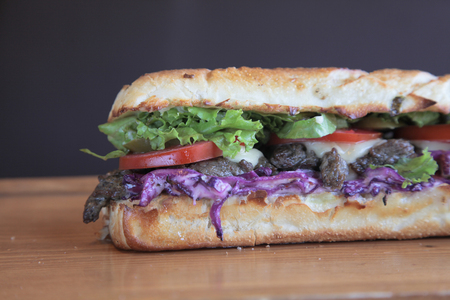 Steak meaty sandwich filled with vegetables Closeup Stock Photo