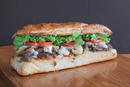 Philly sandwich filled with meat and veggies