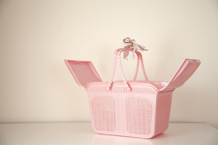 Open Pink basket with copy space on background