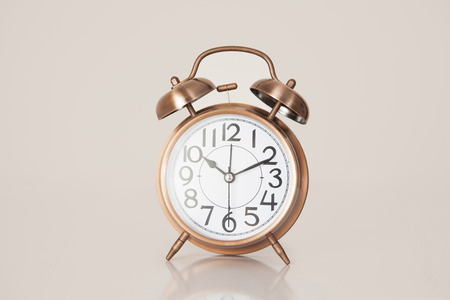 Retro alarm clock on a plain background closeup