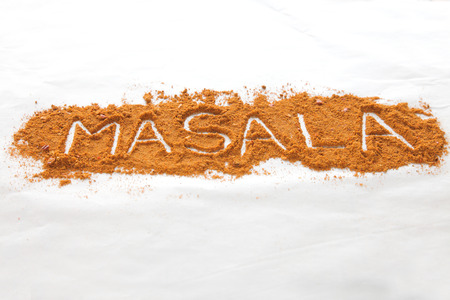 Masala text written in font of spices in perspective Stock Photo