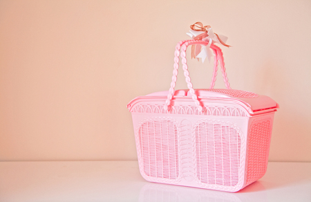 Pink basket with copy space on background Stock Photo