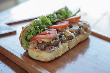 Open faced juicy steak and mushroom sandwich Stock Photo