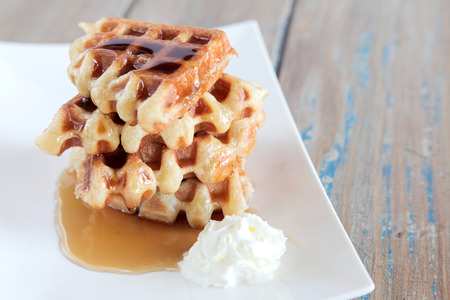 Maple syrup waffle with vanilla whipped cream