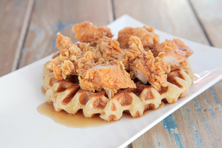 Fried crispy chicken waffle with maple syrup
