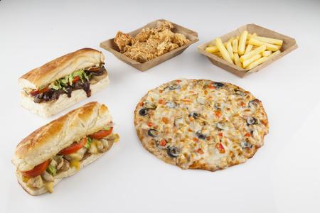 Fiesta junk food sandwiches fries chicken pizza