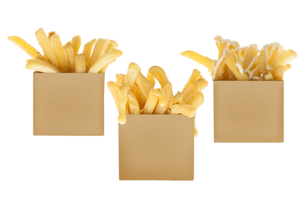 Take away boxes of french fries with plain, cheese and may sauces dips Stock Photo