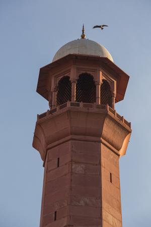 Minaret Tower of calling prayer to muslims close up