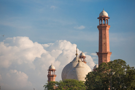 The Emperors Mosque - Badshahi Masjid in Lahore, Pakistan Dome with Minarets with mystical clouds