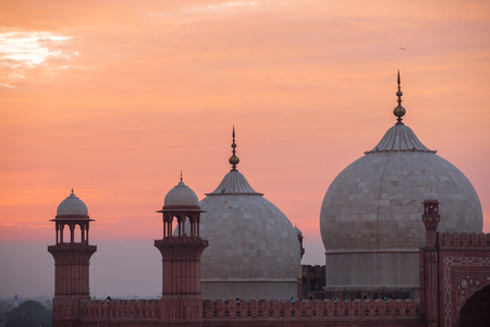The Emperors Mosque - Badshahi Masjid at sunset Фото со стока