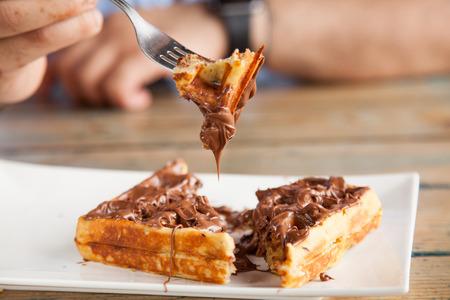Nutella waffle pancake chocolate snack on fork Фото со стока