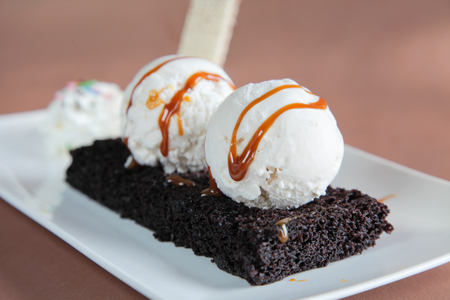 Chocolate Brownie with Vanilla Ice Cream and Syrup