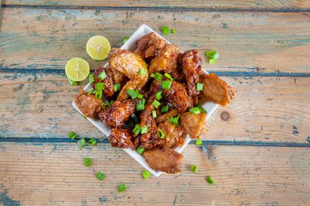 Lemon tantalising chicken wings in square bowl