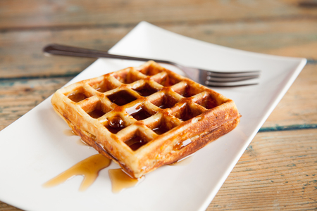 Maple syrup waffle with fork