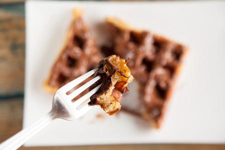 chocolate waffle pancake chocolate snack on fork
