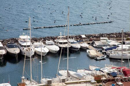View of the famous Borgo Marinari of Naples, ancient town of fishermen, now tourist port with local restaurants and nightlife